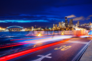 road with cityscape and skyline of seattle