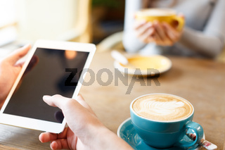 people relaxing in cafe