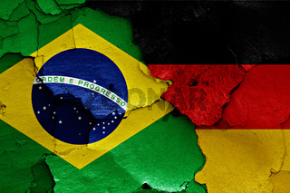 flags of Brazil and Germany painted on cracked wall