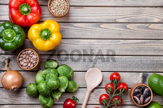 Various vegetables fruits and herbs on wooden background