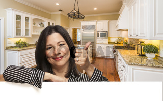 Hispanic Woman with Thumbs Up In Custom Kitchen Interior