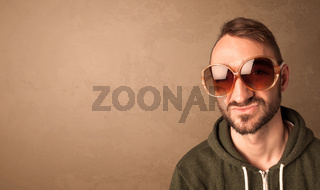 Portrait of a young funny man with sunglasses and copyspace
