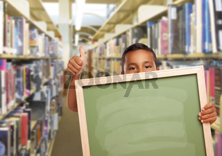 Hispanic Boy with Empty Chalk Board in Library