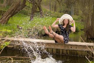 Cheerful fashionable woman on small bridge