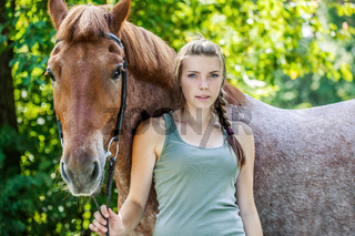 young woman close-up with horse
