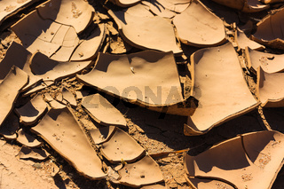 Close up cracks dry riverbed with surface of brown mud. Namibia