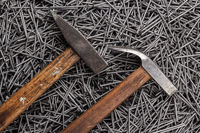 old hammers and nails on table