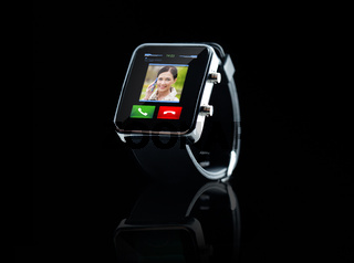 close up of black smart watch with incoming call