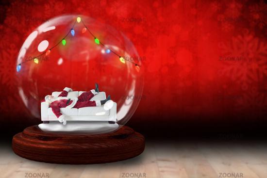 Santa sleeping in snow globe
