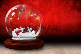 Santa sleeping in snow globe