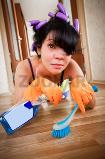 housewife washes a floor