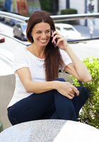 Beautiful latina woman talking on mobile phone
