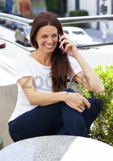 Beautiful latina woman talking on mobile phone