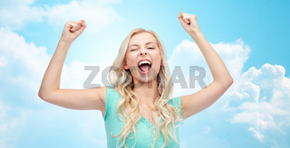 happy young woman or teen girl celebrating victory