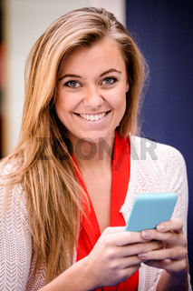 Portrait of beautiful woman using mobile phone