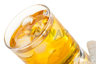Whiskey with ice cubes. Isolated on white