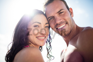 Portrait of young couple embracing each other on the beach