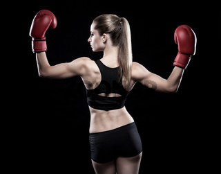 Beautiful woman in great shape wearing boxing gloves