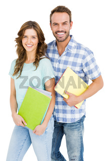 Happy young couple holding book and folder