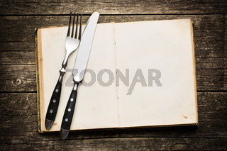vintage book and cutlery