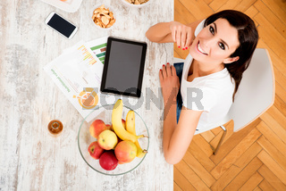 Young beautiful woman with a Tablet PC at home