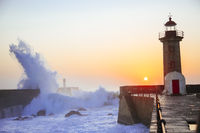 Lighthouse Felgueirasin Porto with wave splash at sunset
