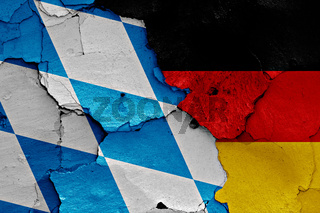 flags of Bavaria and Germany painted on cracked wall