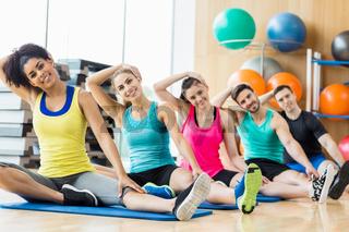 Fitness class exercising in the studio