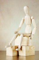 Wooden puppet sitting on the blocks