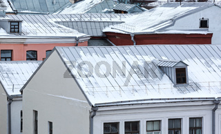 snowy roofs of old houses in winter