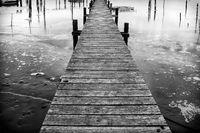Pier over frozen lake in Fredrikstsd in Norway