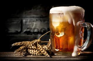 Beer near brick wall