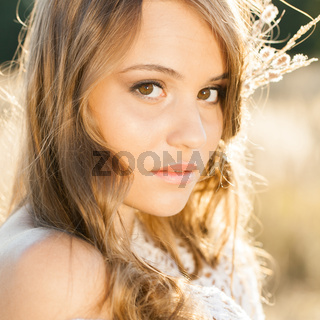 Portrait of a beautiful model  in open field at sunrise