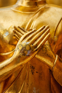 Buddha statue hands close up