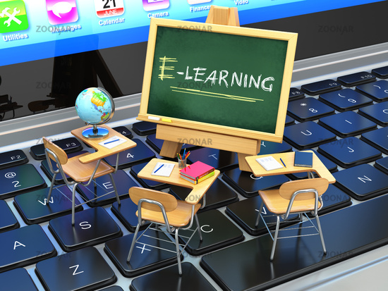 E-learning, online education concept. Blackboard and school desks on laptop keyboard.