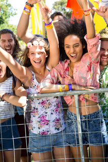 Excited music fans up the front at festival