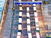Line of Trucks in Port
