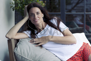 woman relaxing in coach at home