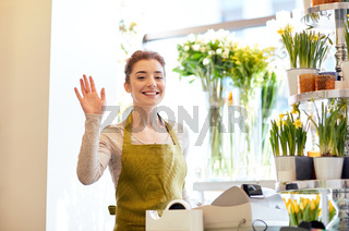 smiling florist woman at flower shop cashbox