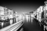 Fast boats on the Grand Canal at night in black and white, Venice, Venezia, Italy, Europe