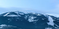 Panoramic image of snowy Carpathian mountains