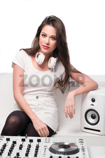 Sexy attractive DJ relaxing on a sofa