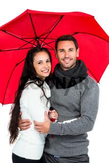 Smiling couple under umbrella