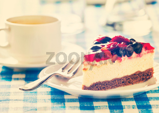 Cake on plate with fork and coffee cup