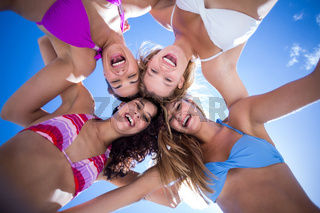 Beautiful women standing in circle
