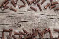 rusty screw bolt on the wooden table