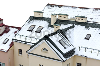 snow covered house roof with skylights