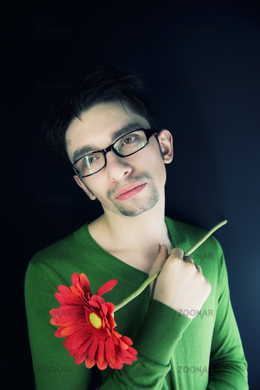 young guy with a red flower