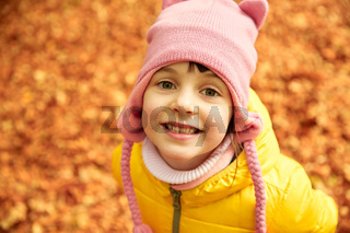 happy little girl in autumn park