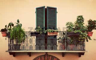 Retro romantic balcony. Window with green shutter. Vintage Italy, Pienza in Tuscany.